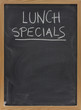 lunch specials on blackboard in vertical