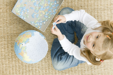 Creative playing with globe puzzle