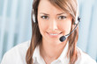 Portrait of happy support phone operator in headset