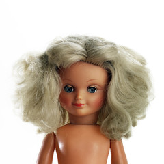 portrait of blond hair plastic doll  isolated on white