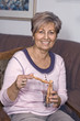 Leinwanddruck Bild - Lady with pretzel sticks