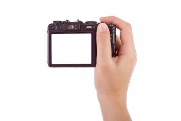 Hand photographing with a digital camera isolated on white.