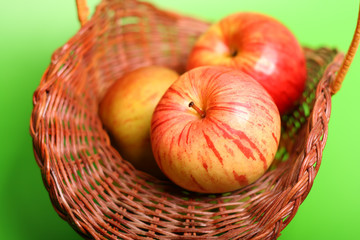 Three apples on the basket