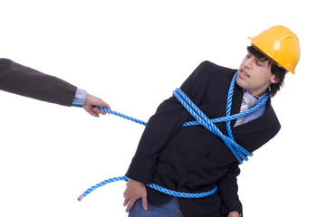 Businessman being pulled by a rope