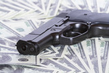 Automatic pistol on background with money poster