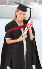 Woman smiling at her graduation