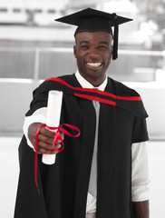Man smilling at graduation