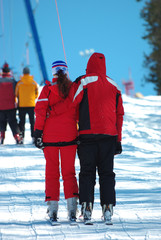 Couple of skiers on the lift