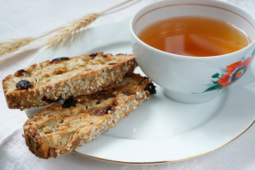 Cup of tea with biscotti cookies