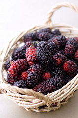 fresh mulberries in a tiny basket