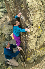 Father and son rock climbing.