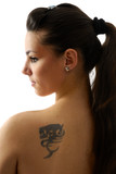 Young brunet woman with tatoo on her shoulder. poster