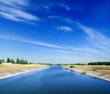 irrigation channel in summer day poster