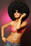 Beautiful woman with huge afro haircut on pink poster