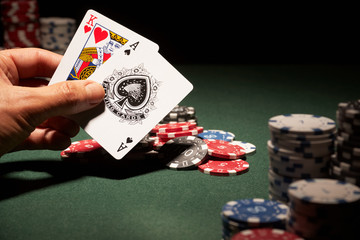 Blackjack hand of cards and casino chips