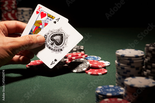 Blackjack hand of cards and casino chips - 13563974