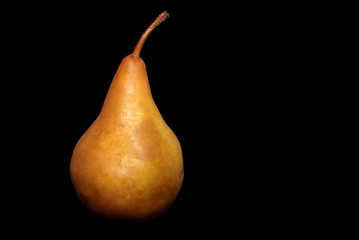 One Pear on a black background