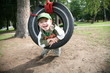 Young Boy in Tire Swing