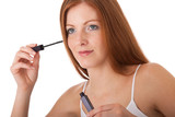 Body care series - Beautiful red hair woman applying mascara poster