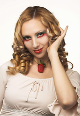Portrait of pretty blonde with fresh strawberry