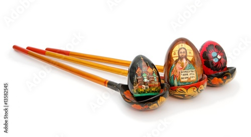 Easter eggs in Russian wooden painted spoons isolated