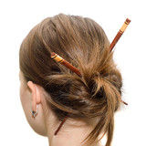 Woman coiffure with asian sticks poster