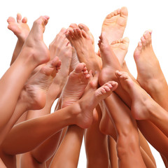 Beautiful female slim feet of group of girls