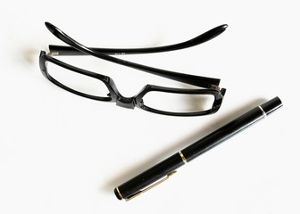 Eyeglasses, fountain pen