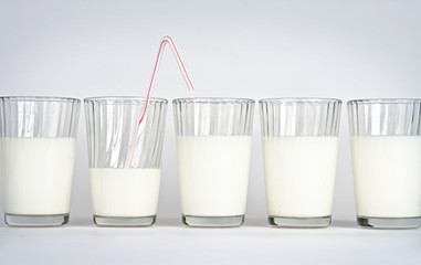 Milk glasses on a white background