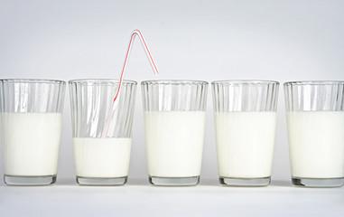 Milk glasses on a white background