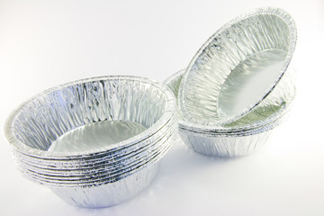 Stacks of small round catering trays