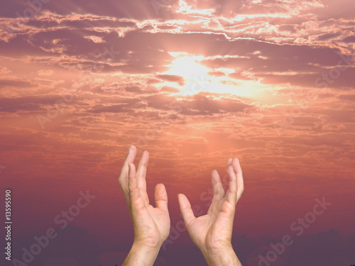 hands streaching out to sky as a symbol of people hope and sapir