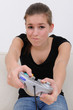 teenage girl playing playstation