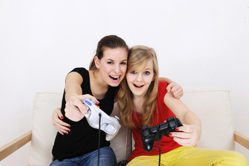 teenage girls playing playstation