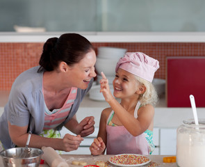 Mother and Daugther having fun together in the kitchen