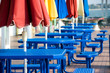 Blue tables with colorful umbrellas