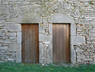 Wooden doors in a stone building