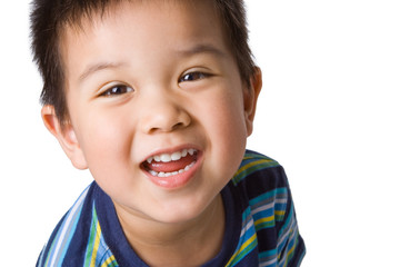 Happy Asian preschool-aged boy, close up