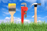 Home Improvement Tools Paintbrush, Pipe Wrench and Hammer poster
