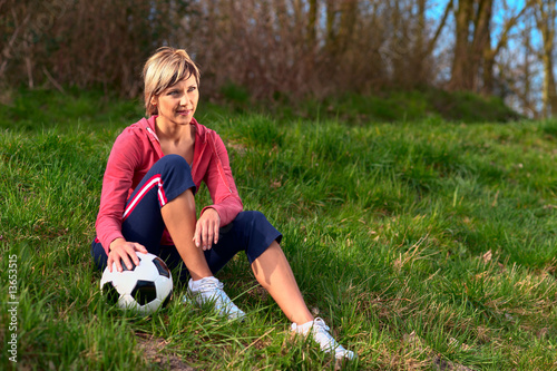 Sportswoman Sitting with a Ball