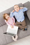 Mocking children with laptop poster
