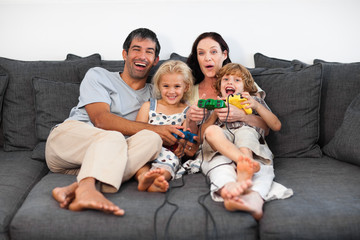 Family on Sofa Playing Video games