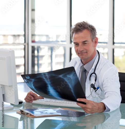 Mature Doctor looking at an x-ray