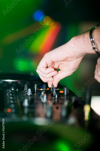Deejay's hand and turntable
