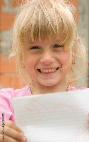 Child showing paper