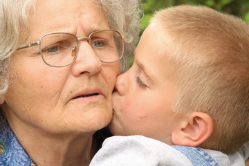Boy kisses grandmother