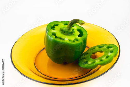 cut pepper on a plate on a white background