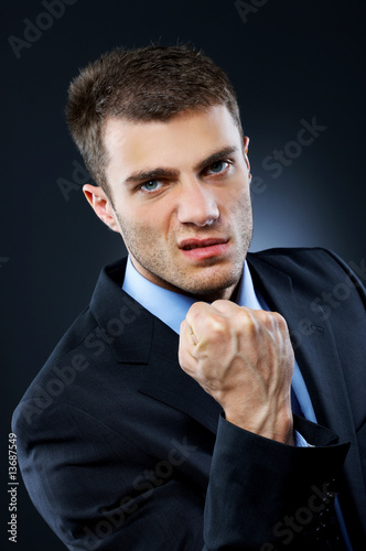 Portrait of business man isolated on dark background