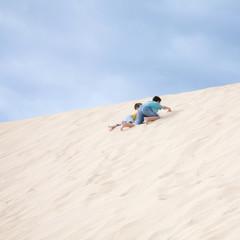 two boys climbing uphill