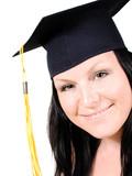 smiling brunet student girl in cap over white poster